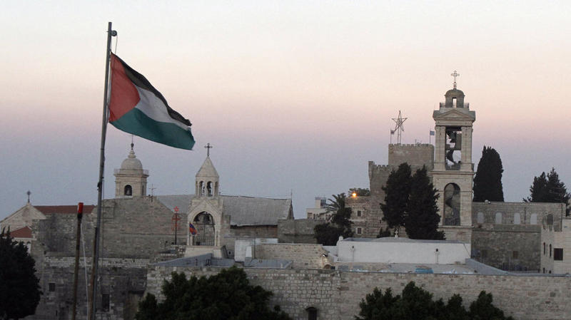 The Palestinian flag flutters in front of the Church of the Nativity in the biblical West Bank town of Bethlehem in 2012.