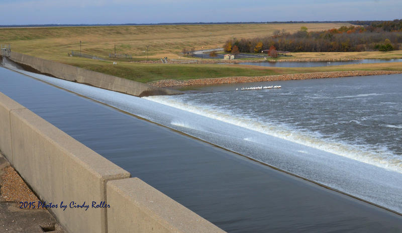Waters rush over the spillway at Cooper Lake, an occassion that happens only rarely in Delta County.