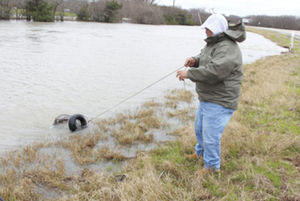 The fishing was good Monday along east Lee Street/Business Highway 69 in Greenville. Chili Gonzalez said he was able to fill up two baskets with catches in about 30 minutes, as he cast his line into the flood waters along the roadway.