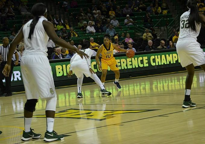 Junior guard Khala Riley looks for an open lane against Baylor.