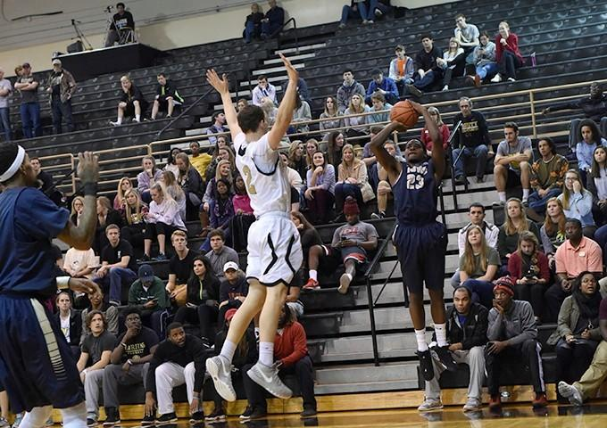 Senior guard J.R. Owens pulls up for a three-pointer against Harding.