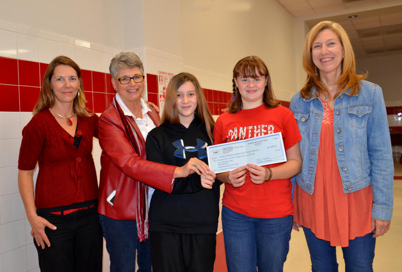 Receiving the check from Dr. Marnie Rout of EcoVerdant and Libby Horton were North Hopkins students Lily Clayton and Jessica Hatley with teacher Janis Thomas.