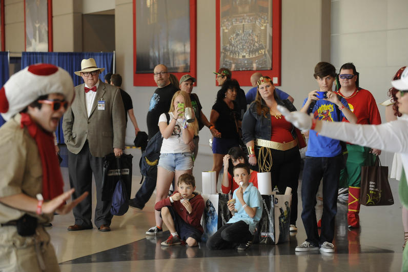 Fans watch the Mario Bros. dance