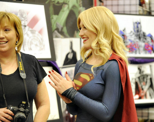 Supergirl laughs with friends