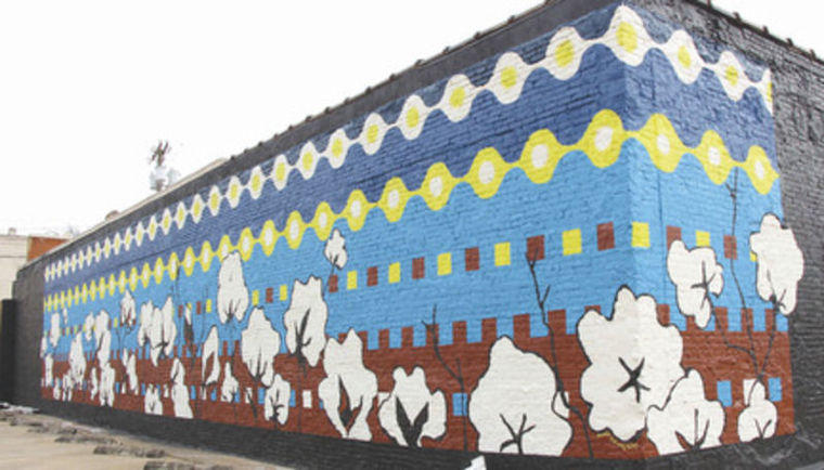 """High Cotton"", an abstract mural created by local artist Pamela Edwards was completed last month and covers the north wall and a potion of the west wall of the Scott & Ray Attorneys office building, at the corner of Washington and Stonewall streets."
