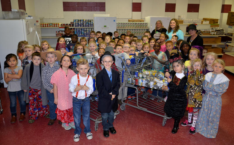 Cooper Elementary first grade students performed 100 acts of kindness for the 100th day of school Tuesday morning by delivering 100 canned goods to the Delta Hope House.