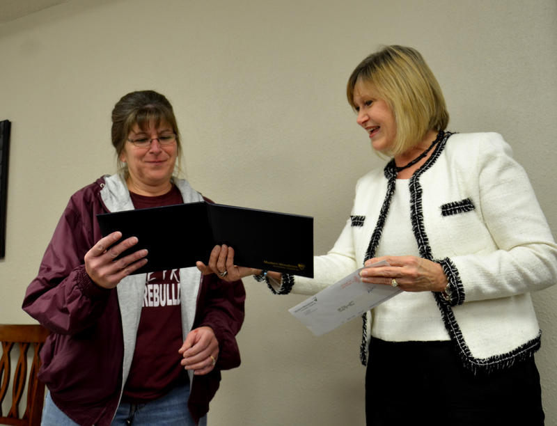 Diane Stegall with Modern Woodmen of America presents Pam Toon with the Hometown Hero Award during a recent Cooper ISD Board of Trustees meeting.