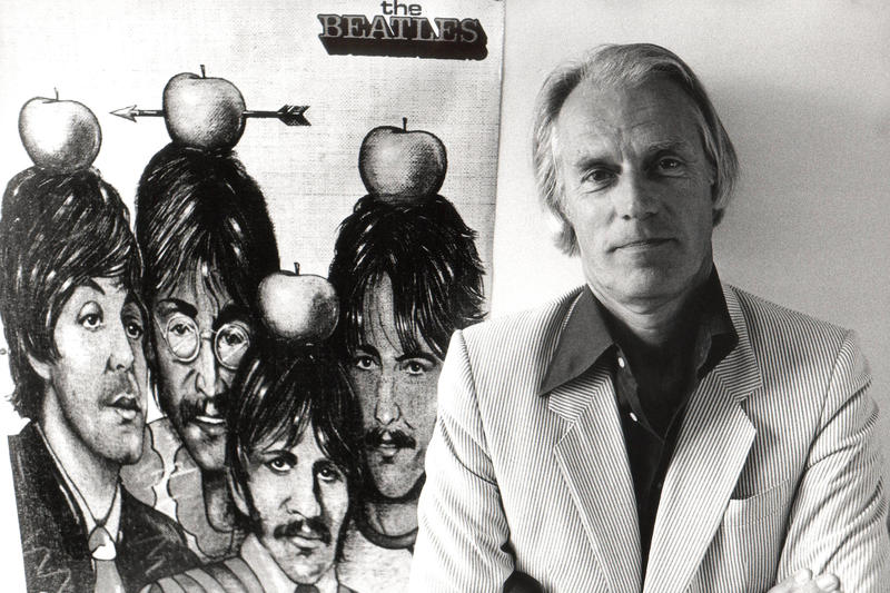 Martin stands with poster of the Beatles in 1984.