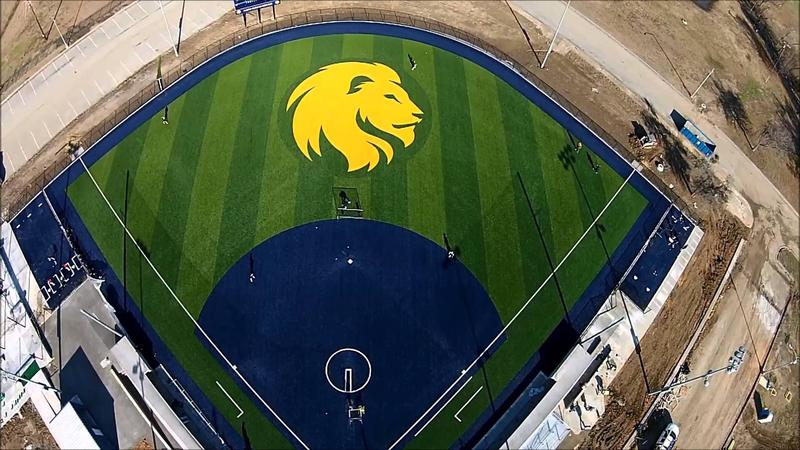 The Lions' new softball facility features a blue infleld and a Texas-sized logo in the outfield.