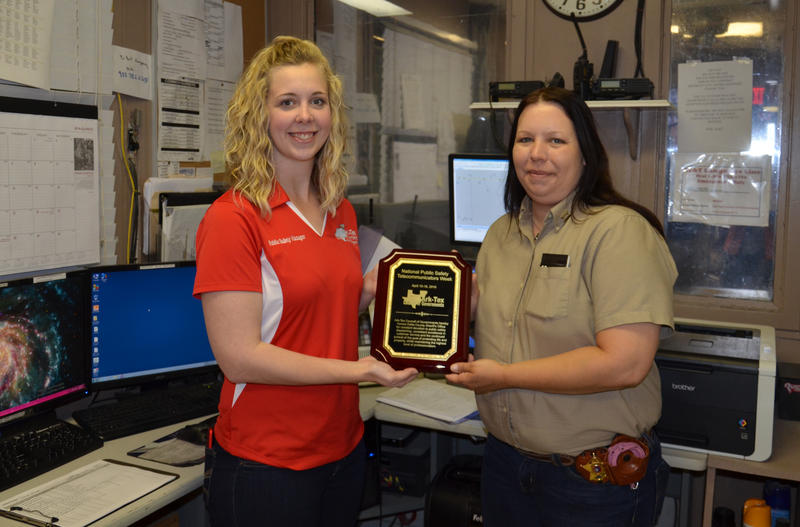Mary Beth Rudel, ATCOG Safety Manager presents Delta County Dispatcher Sue Ann Johnson with their plaque of appreciation for Safety Week.