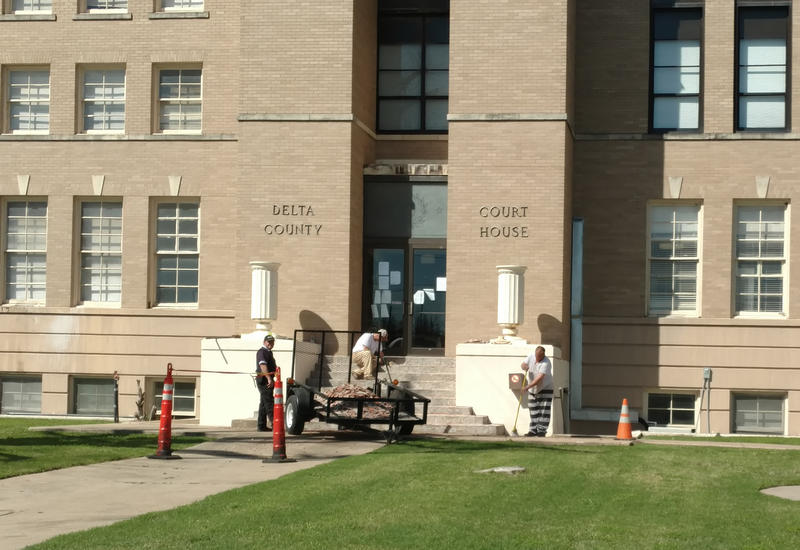 The inmate work crew helped remove the tiles from the Delta County Courthouse steps. Both entrances on the south and east sides are complete.