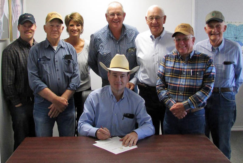 Delta County Judge Jason Murray (seated) signs the Soil & Water Stewardship Week Proclamation. With him is (pictured from left) Trey Watson, State Board Representative; Robert Wright, Delta SWCD director; Kristi Mashburn, NRCS District Conservationist; Ed