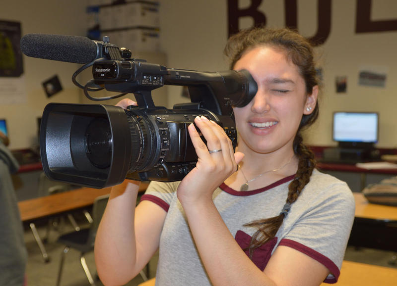 Cooper High School student Elly Galvan is holding the video camera.