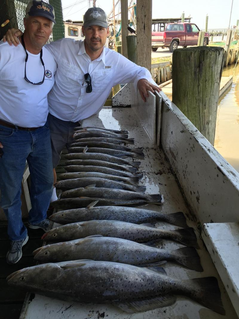 Clients of Capt. David Dillman show off their Galveston Bay catch
