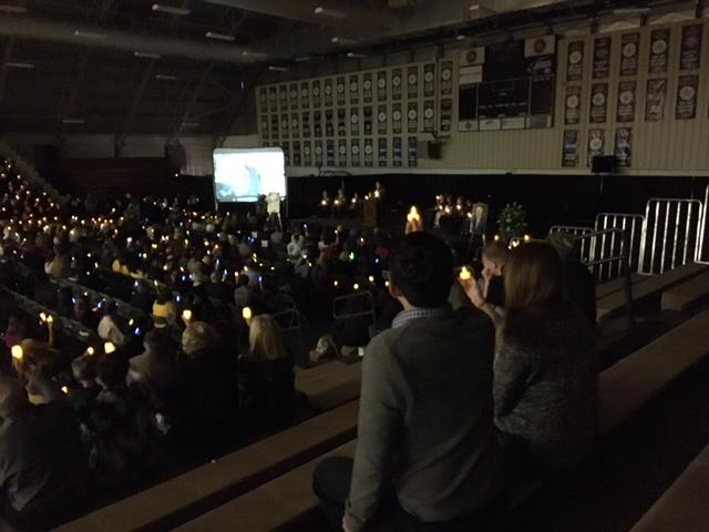 The lights in the Field House were turned off, and the crowd held a minute of silence.