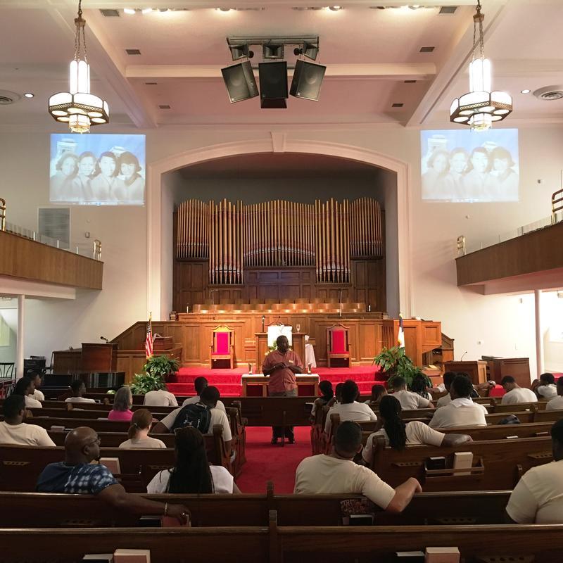 Students hear a presentation inside 16th Street Baptist Church.