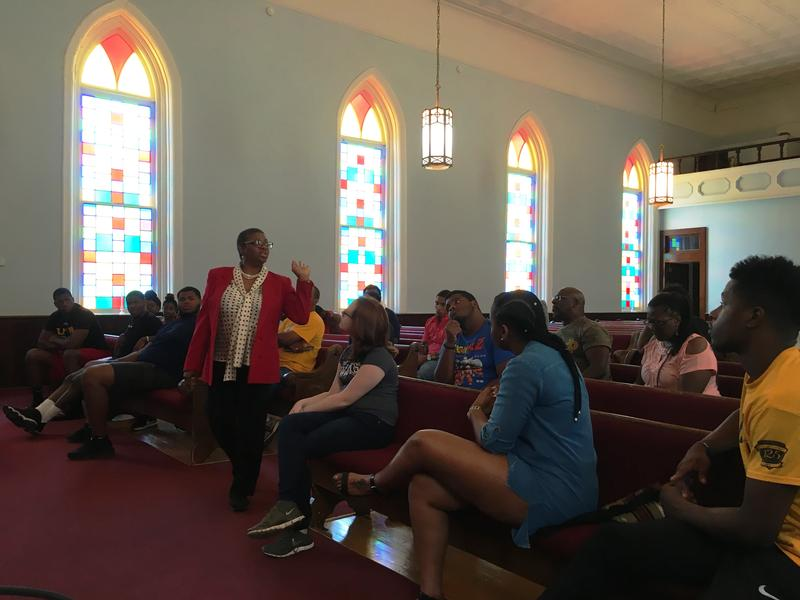 A tour guide tells students the story of Dexter Avenue Baptist Church in Montgomery.