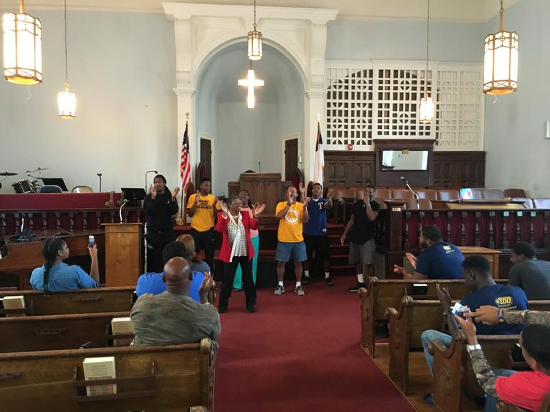 Students sing in the sanctuary at Dexter Ave. Baptist Church.