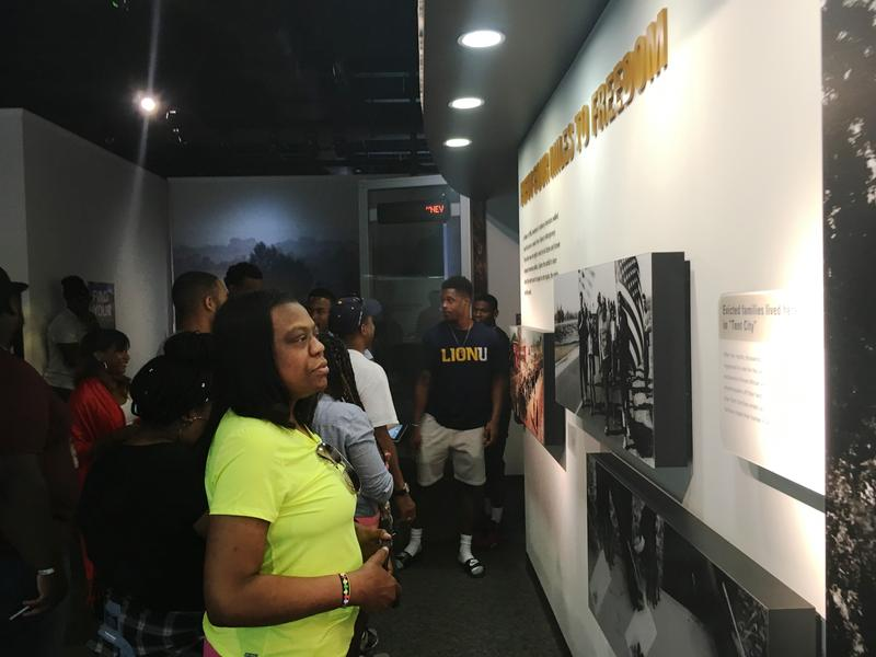 Student Sonia Smith-Miller reads an exhibit at the Lowndes Interpretive Center on the Selma to Montgomery National Historic Trail in Alabama.
