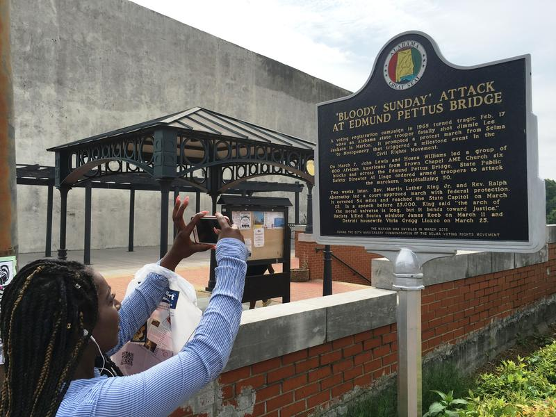 Kia Price photographs the historical marker at the site of Bloody Sunday in Selma.