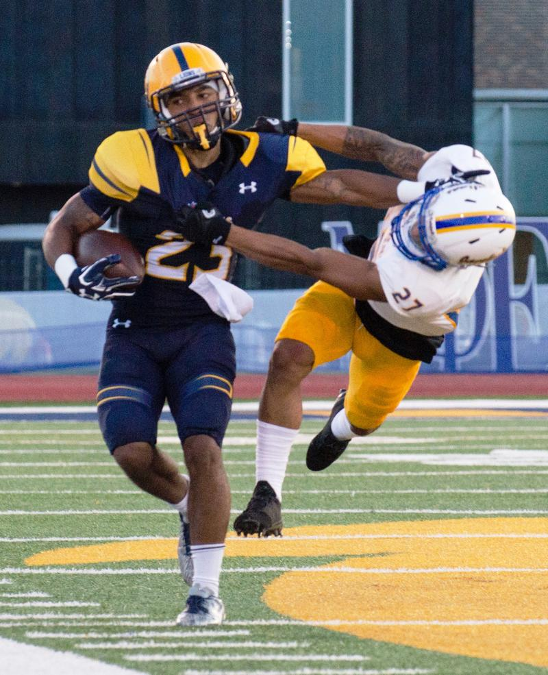 Richard Cooper carries for the Lions during A&M-Commerce's 38-36 victory over A&M-Kingsville in Commerce on Sept. 24.