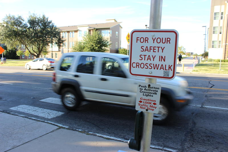 An SUV crosses the crosswalk near Texas A&M University-Commerce.