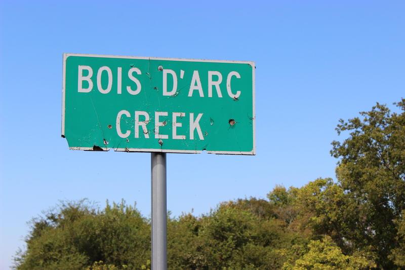 A road sign marks Bois d'Arc Creek outside of Bonham, TX.