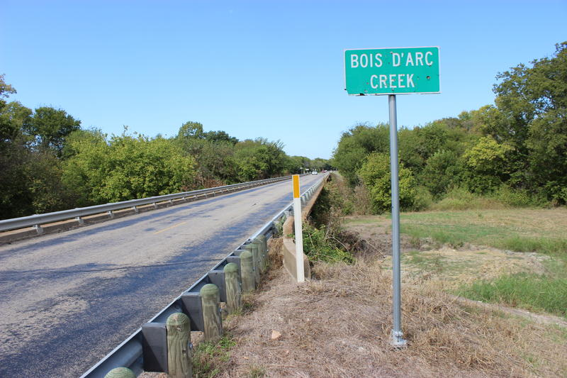 A road sign marks Bois d'Arc Creek outside of Bonham.