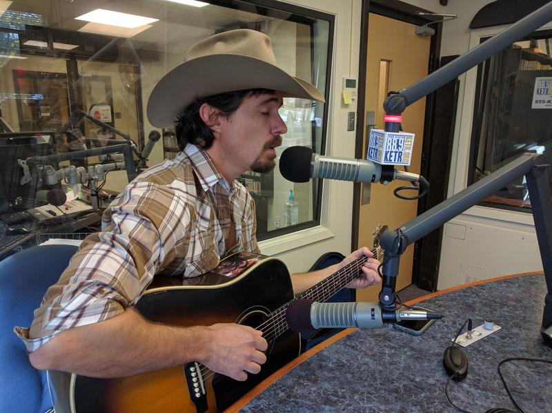 Zane Williams playing a song live during Notably Texan in the KETR Studios..