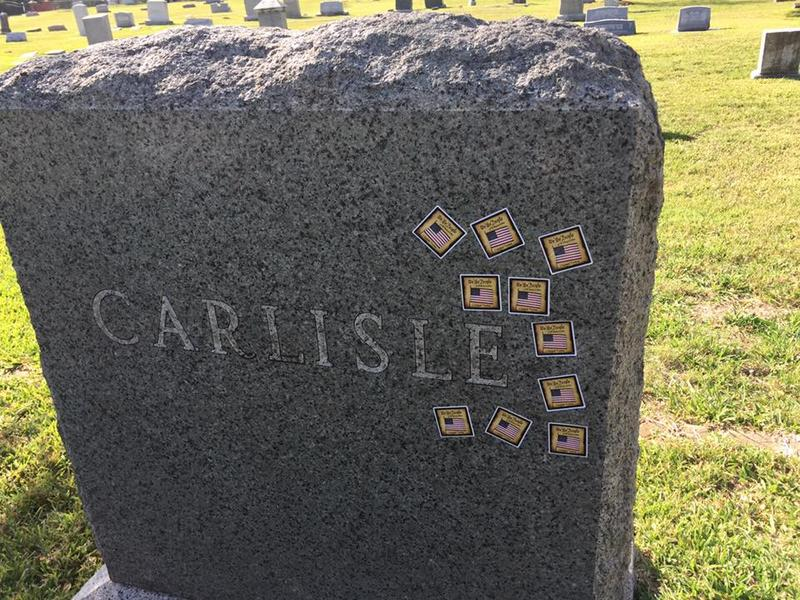 "Carlisle headstone with ""I voted"" stickers"