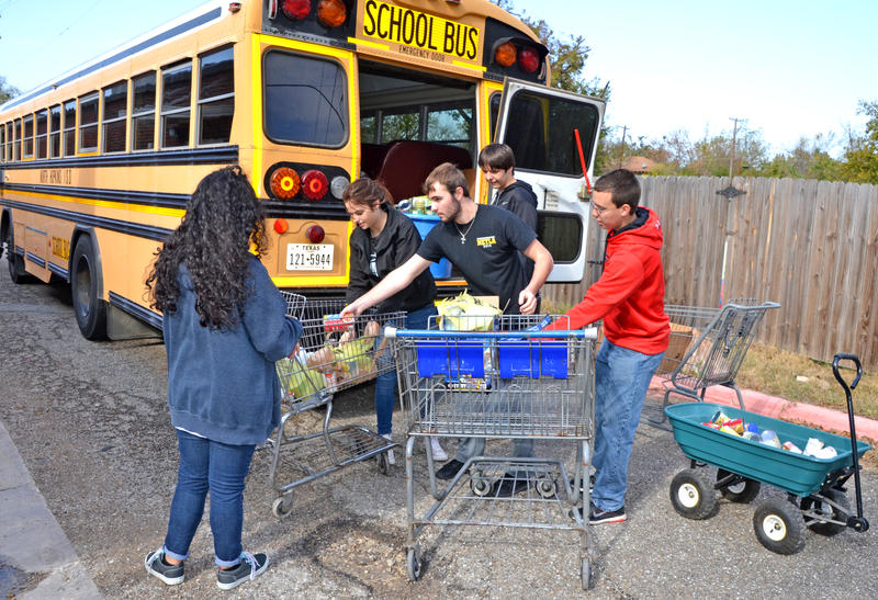 North Hopkins ISD Beta Club members Brittany Aguinaga, Hollie Stidham, Christian Mattock, Colton Ross and Aaron Stanley fill grocery carts full of food donations last Friday outside of the Delta Hope House. The school delivered 1.3 tons of donated food.