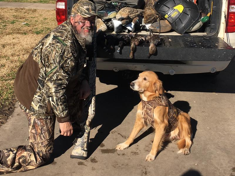 Jason Bearden with one of his hunting dogs.