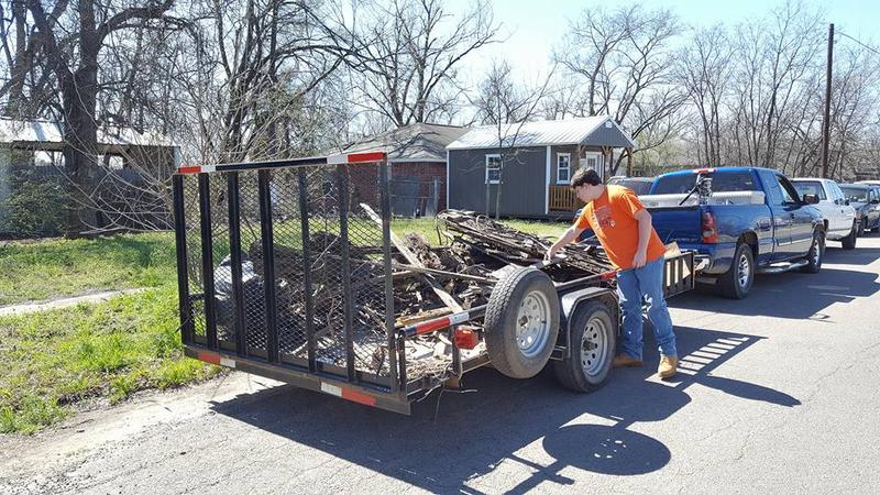 Even the youth are participating in the Cooper Clean-Up Crew like Beau Neal putting branches on a trailer. The next clean-up date is this Saturday, March 18 at 8 a.m. in the City Park.