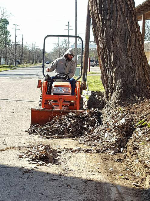 Randy Turner was just one of the 39 volunteers helping to clean the streets of Cooper. He was gathering debris on Southeast First Street with the Cooper Clean-Up Crew.