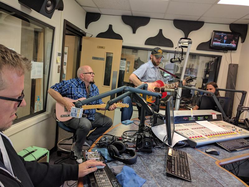 Charlie & The Regrets performing a song in the KETR Studios. (Left to right) Lap Steel Guitarist Willy Golden, Lead Guitarist John Shelton, Singer & Guitarist Charlie Harrison, and Bassist/Backup Vocalist Mark Riddell.