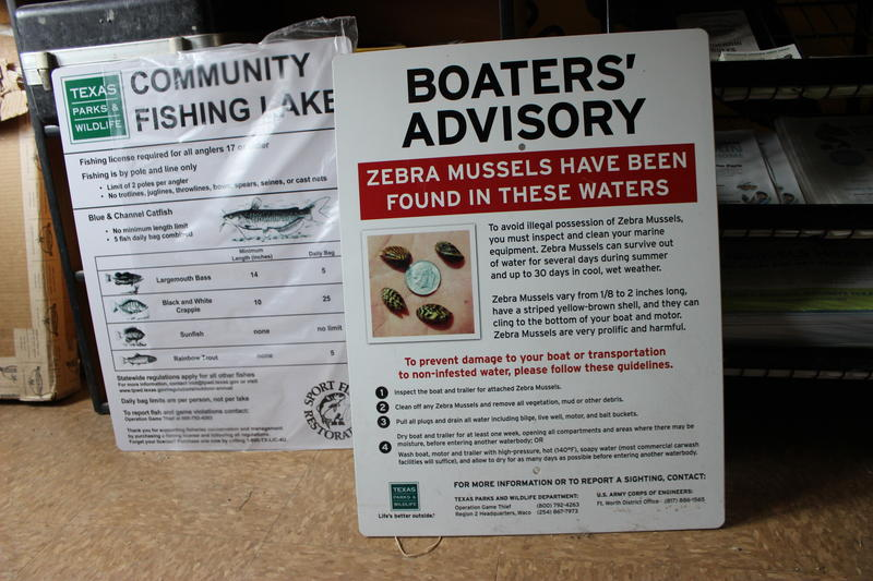 A sign warns boaters about zebra mussels, at a Texas Parks and Wildlife Office in Fort Worth.
