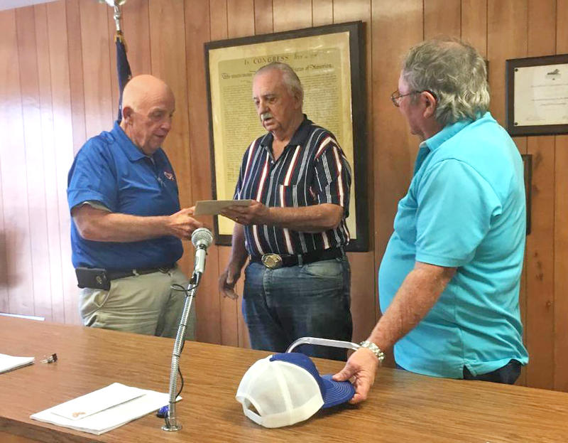 Mayor Stegall is presented a gift from the Council by E.J. Cates and David Phillips.