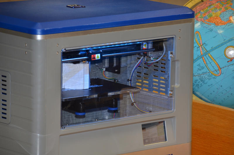 New 3-D printer available for students to learn is located in the library.
