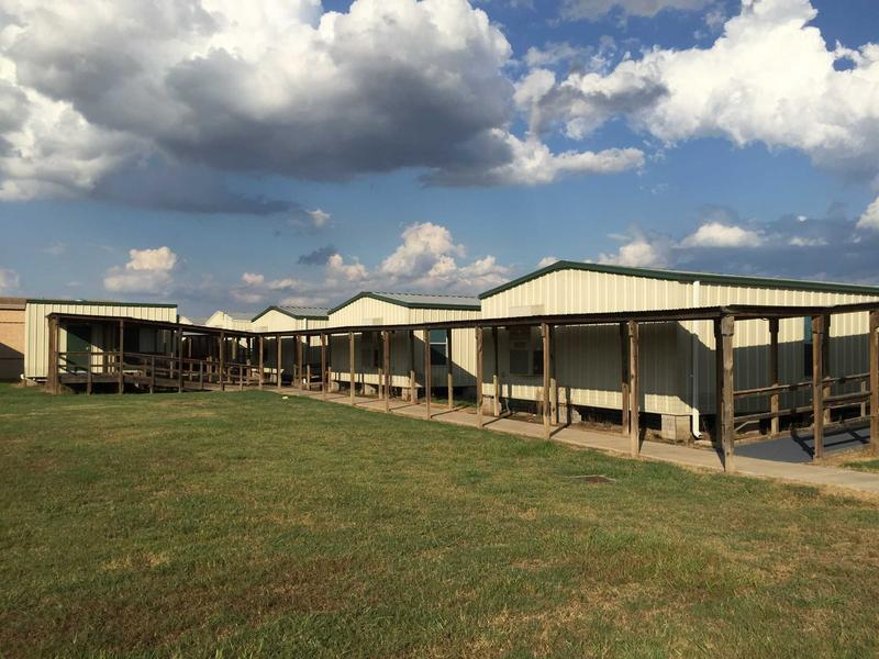 Many Texas school districts have turned to portable buildings, like these in use in Katy, to manage growing student populations and stagnant school district budgets.