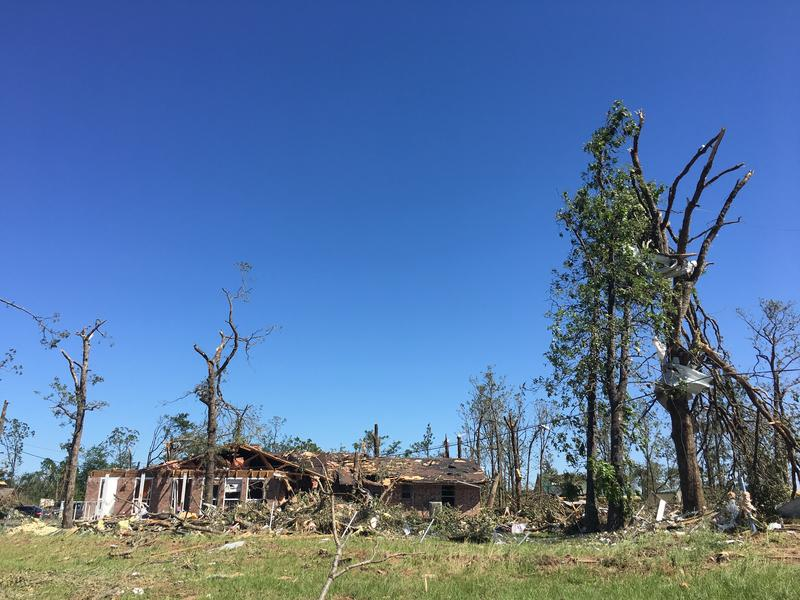 Work crews on Monday continued to clean up the aftermath of the April 29 tornado.