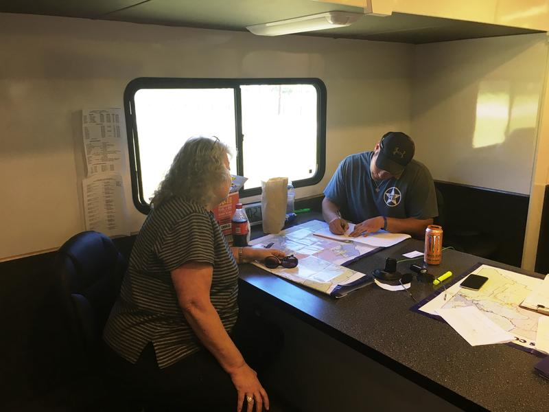 Local officials remained busy Monday afternoon at the command center on U.S. Hwy. 69.