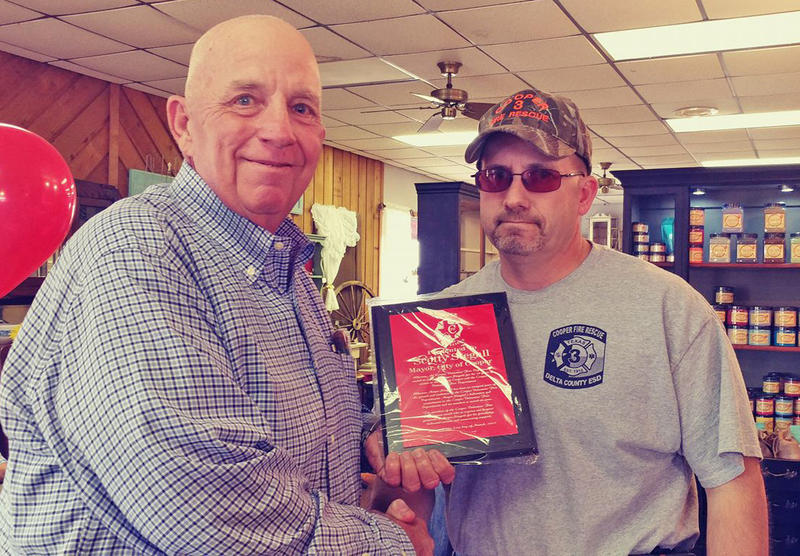 At his retirement reception Mayor Stegall received an honor from Cooper Volunteer Fire Chief Chuck Toles.