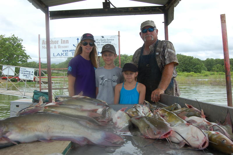 "Lake Tawakoni guide David Hanson (903-268-7391)  with a big ""mess"" of catfish caught with Luke's daughter Ashley and two of her youngsters, Anna and Conner."