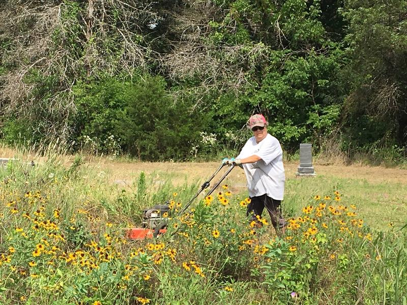Zogail Smith helps mow overgrown areas of Simmons Cemetery.
