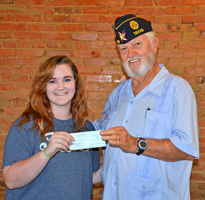 Eryn Whirley is presented her $1,000 scholarship by Red Henderson Post 483 Vice Commander Butch Burns.