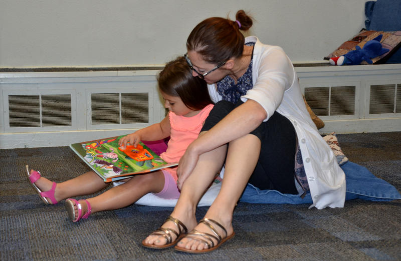 "Lindsay Glossup and her daughter Elise enjoy some reading time together following the new ""Story Time"" event at the Delta County Public Library."