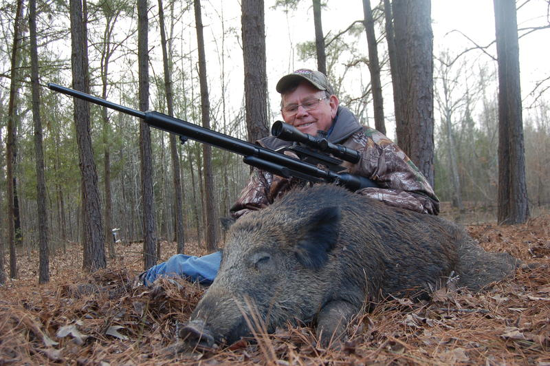 Luke Clayton with wild hog he took with his .45 caliber Airforce Airguns Texan shooting a 350 grain Hunters Supply bullet.