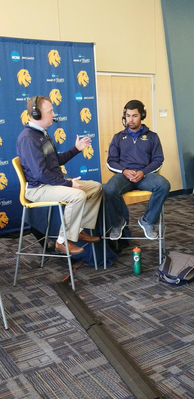 Josh Manck discusses the Lions Golf team with senior Wilfredo Sanchez