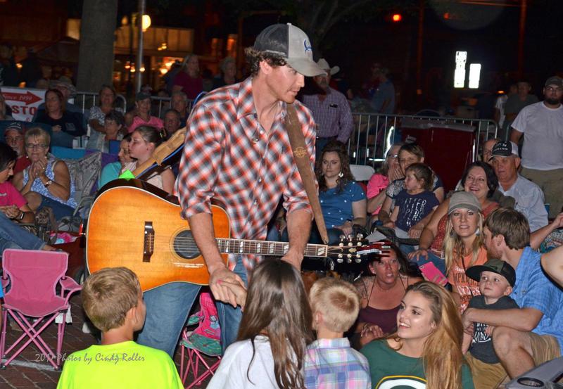 Curtis Grimes entertains the fans at the Cotton Harvest Festival.