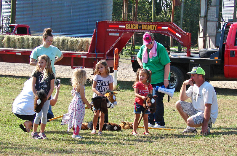 Children enjoyed many fun games like this stick horse event at Pecan Fest.